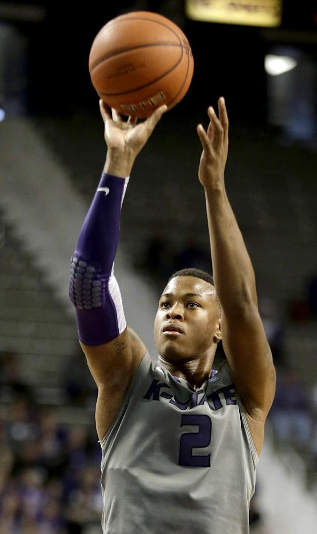 Kansas State's Marcus Foster puts up a shot during the second half of an NCAA college basketball game against Long Beach State Sunday, Nov. 17, 2013, in Manhattan, Kan. Kansas State won 71-58. (AP Photo/Charlie Riedel)