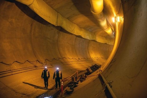 Crew workers pictured during the excavation of two river giant tunnels to reroute the Peace River as part of the Site C dam project.  (BC Hydro/contributed  - image credit)