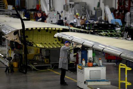 FILE PHOTO: A worker inspects a C Series airplane wing in the Bombardier factory in Belfast