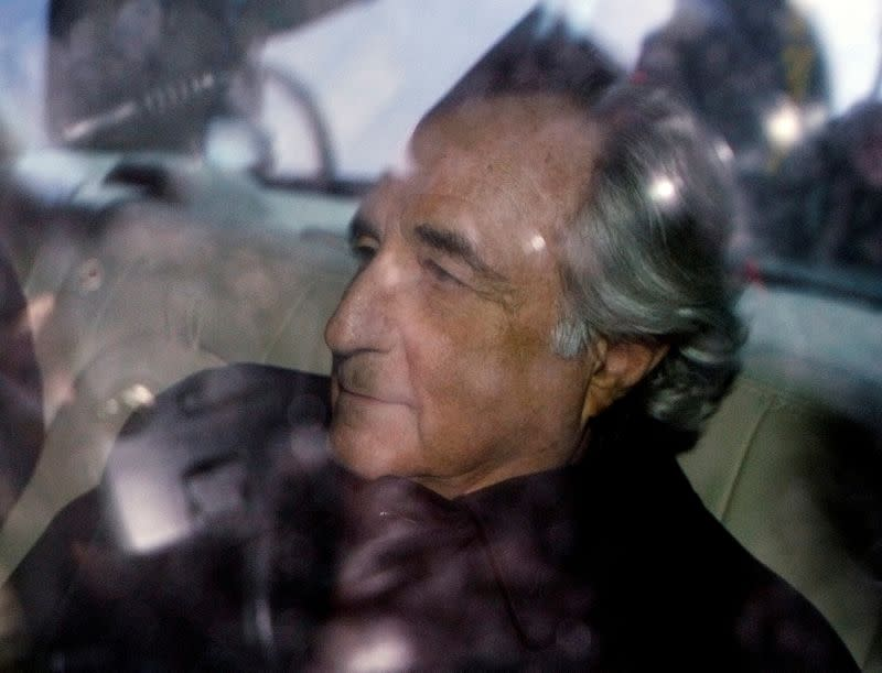 FILE PHOTO: Bernard Madoff is escorted from Federal Court in New York