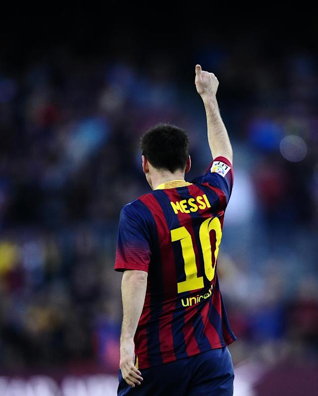 FC Barcelona's Lionel Messi, celebrates after scoring during the Spanish La Liga soccer match between FC Barcelona and Osasuna at the Camp Nou stadium in Barcelona, Spain, Sunday, March 16, 2014. (AP Photo/Manu Fernandez)