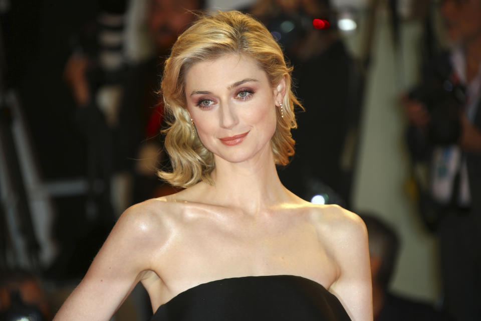 "FILE - Actress Elizabeth Debicki poses for photographers upon arrival at the premiere of the film 'The Burnt Orange Heresy' at the 76th edition of the Venice Film Festival, Venice, Italy, in a Saturday, Sept. 7, 2019 file photo.  Elizabeth Debicki will play the Princess of Wales in seasons five and six of ""The Crown,"" the Netflix series announced Sunday, Aug. 16, 2020. (Photo by Joel C Ryan/Invision/AP, File)"