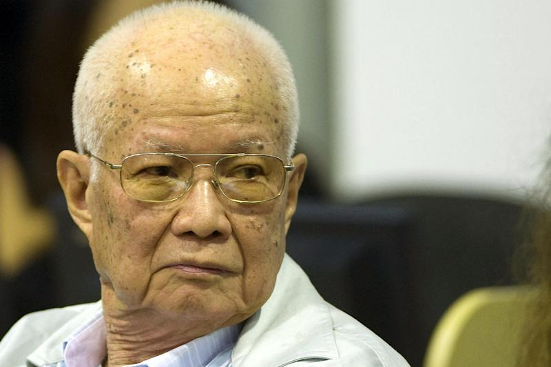 Handout photo taken and released by the Extraordinary Chamber in the Courts of Cambodia (ECCC) on August 7, 2014 shows former Khmer Rouge head of state Khieu Samphan (C) in the ECCC courtroom in Phnom Penh (AFP Photo/Mark Peters)