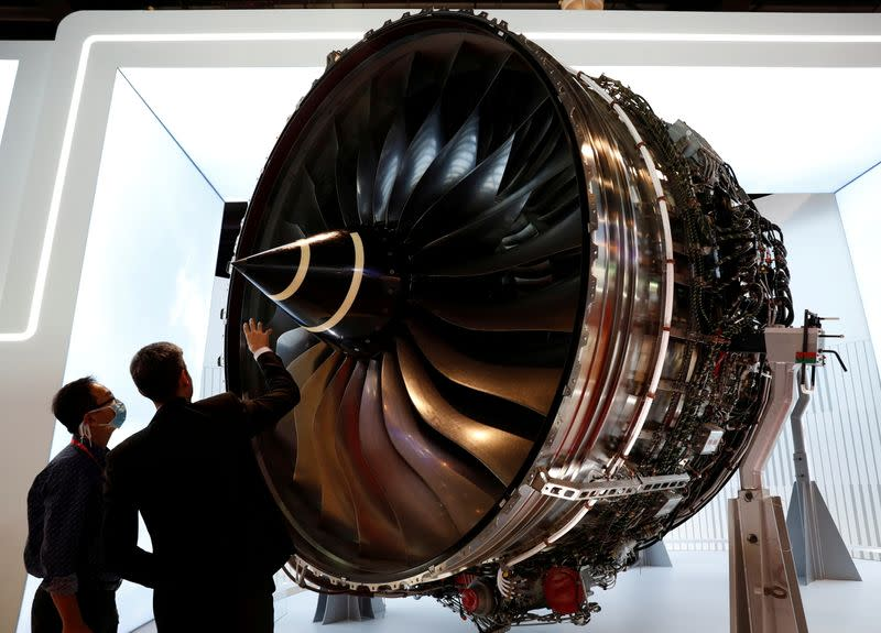 FILE PHOTO: People look at Rolls Royce's Trent Engine displayed at the Singapore Airshow in Singapore