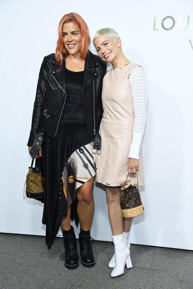 <p>Old friends are the best friends, right Busy and Michelle? The women attended a Louis Vuitton event at Paris Fashion Week together. (Photo: Pascal Le Segretain/Getty Images) </p>