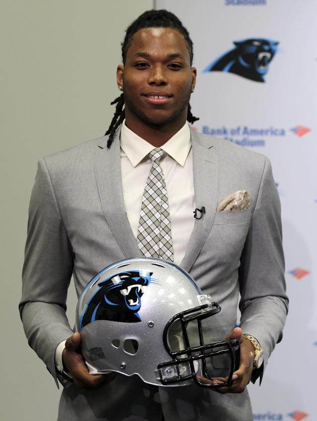 Carolina Panthers' first-round draft pick Kelvin Benjamin poses with a team helmet during a news conference in Charlotte, N.C., Friday, May 9, 2014. The team is counting on Benjamin developing into their No. 1 receiver down the road, but realize it will take some time for him to develop after only one season as a college starter. (AP Photo/Chuck Burton)
