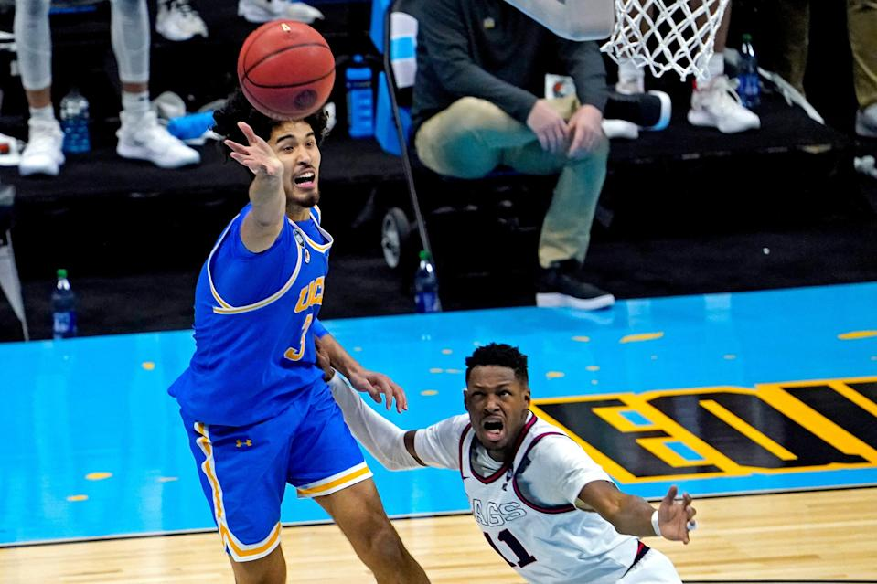 Apr 3, 2021; Indianapolis, Indiana, USA; UCLA Bruins guard Johnny Juzang (3) and Gonzaga Bulldogs guard Joel Ayayi (11) go for the ball during the second half in the national semifinals of the Final Four of the 2021 NCAA Tournament at Lucas Oil Stadium. Mandatory Credit: Robert Deutsch-USA TODAY Sports ORG XMIT: IMAGN-450929 ORIG FILE ID:  20210403_pjc_usa_279.JPG