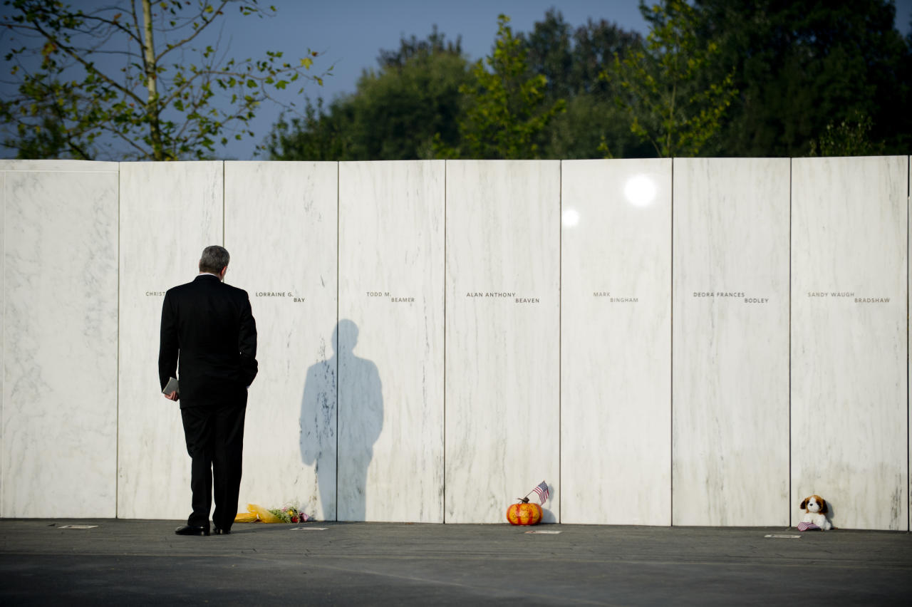 SHANKSVILLE, PA - SEPTEMBER 11: A visitor walks along the Wall of Names during the ceremony marking the 10th anniversary of the crash of United Flight 93 at the Flight 93 National Memorial on September 11, 2011 in Shanksville, Pennsylvania.  An estimated crowd of 5,000 watched as the memorial wall was unveiled with the names of the 40 passengers who died when the plane crashed during the terrorist attacks on September 11, 2001. (Photo by Jeff Swensen/Getty Images)