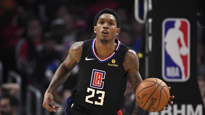 """Clippers guard Lou Williams had 22 points in the Clippers' 99-90 win over the Orlando Magic on Wednesday in an NBA restart exhibition game in Orlando, Fla. <span class=""""copyright"""">(Mark J. Terrill / Associated Press)</span>"""