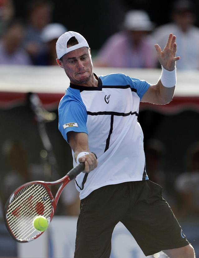 Australia's Lleyton Hewitt makes a forehand return to Andy Murray of Britain during an exhibition match at the Kooyong Classic ahead of the Australian Open tennis championship in Melbourne, Australia, Friday, Jan. 10, 2014. (AP Photo/Aijaz Rahi)