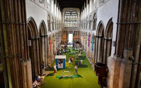 Rochester Cathedral attracted criticism for opening a minigolf course in its nave - Credit: AFP