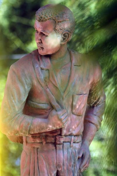 Close-up of a monument in memory of Sigfrido Chavez, the first local resident to migrate to the US in 1967 from the town of Intipuca, southeast of San Salvador