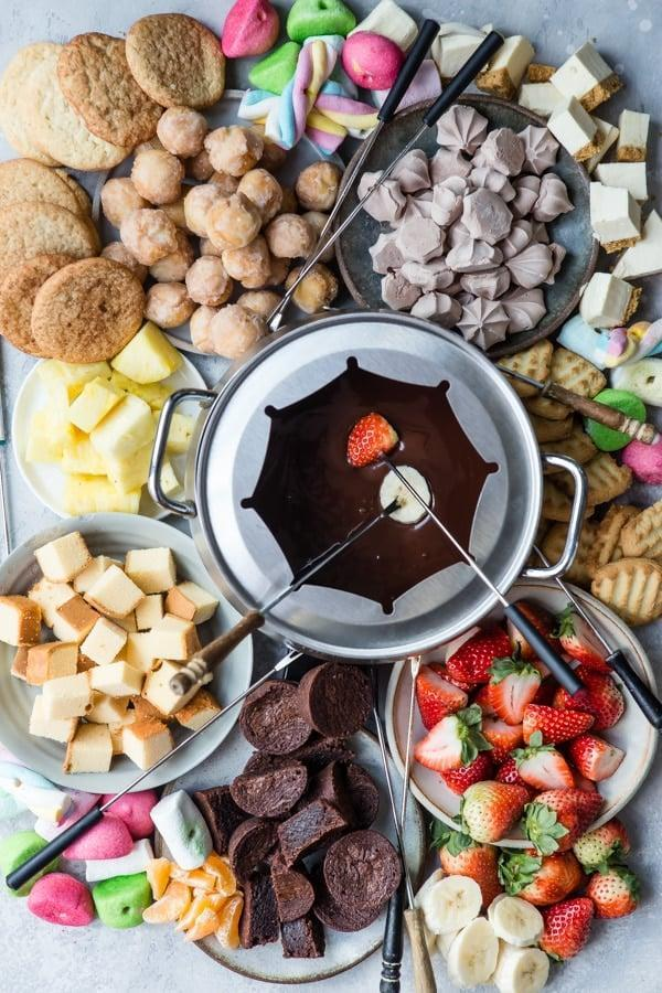 "<p>Craving chocolate? Good! This easy fondue recipe only calls for the essentials (aka heavy cream, dark and milk chocolate, and vanilla extract). Once you whip up this rich masterpiece, just add fresh fruit, bread slides, or marshmallows to dip into it.</p> <p><strong>Get the recipe</strong>: <a href=""https://www.culinaryhill.com/chocolate-fondue/"" class=""link rapid-noclick-resp"" rel=""nofollow noopener"" target=""_blank"" data-ylk=""slk:four-ingredient chocolate fondue"">four-ingredient chocolate fondue</a></p>"
