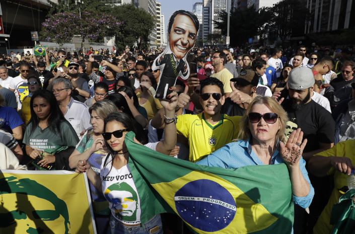 Supporters of Jair Bolsonaro, presidential candidate for the National Social Liberal Party who was stabbed during a campaign event days ago, march along Paulista Avenue to show support for him in Sao Paulo, Brazil, Sunday, Sept. 9, 2018. Brazil will hold general elections on Oct. 7. (AP Photo/Andre Penner)