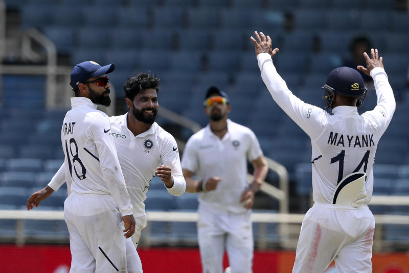 India's Ravindra Jadeja, second from left, celebrates taking the wicket of West Indies' Jahmar Hamilton during day four of the second Test cricket match at Sabina Park cricket ground in Kingston, Jamaica Monday, Sept. 2, 2019. (AP Photo/Ricardo Mazalan)