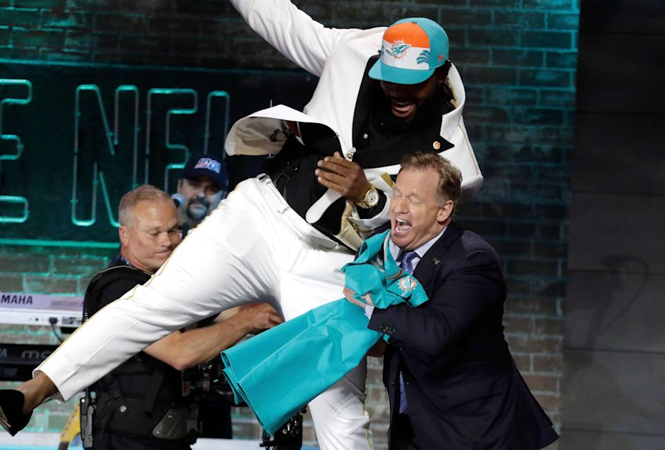 Clemson defensive tackle Christian Wilkins jumps into NFL Commissioner Roger Goodell after the Miami Dolphins selected Wilkins in the first round at the NFL football draft, Thursday, April 25, 2019, in Nashville, Tenn. (AP Photo/Steve Helber)
