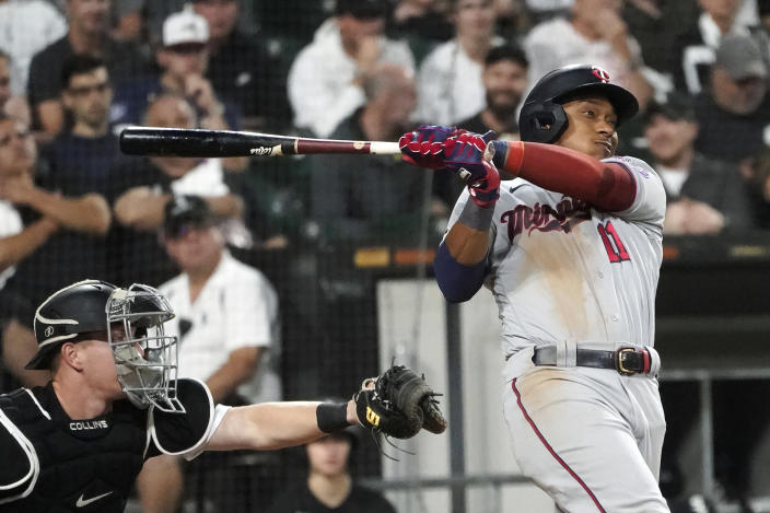 Minnesota Twins' Jorge Polanco singles off Chicago White Sox starting pitcher Dylan Cease as catcher Zack Collins watches during the fifth inning of a baseball game Wednesday, July 21, 2021, in Chicago. (AP Photo/Charles Rex Arbogast)