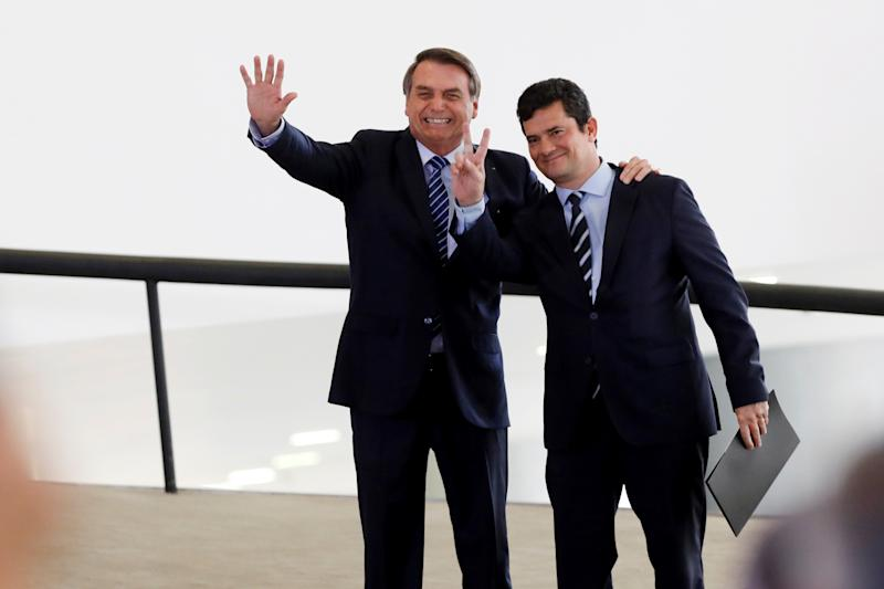 Brazil's President Jair Bolsonaro and Brazil's Justice Minister Sergio Moro gesture during a launching ceremony of public policies against violent crimes at the Planalto Palace in Brasilia, Brazil August 29, 2019. REUTERS/Adriano Machado