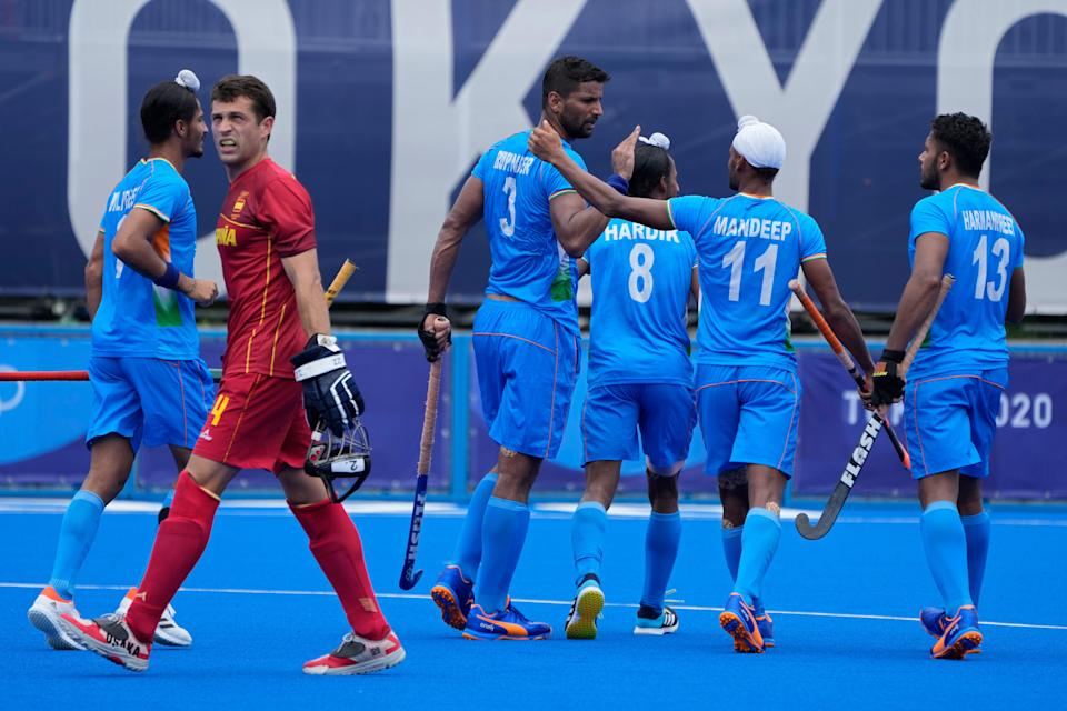 India's Rupinder Pal Singh (3) celebrates after scoring against Spain during a Men's hockey group stage match in Tokyo on Tuesday, 27 July (AP)