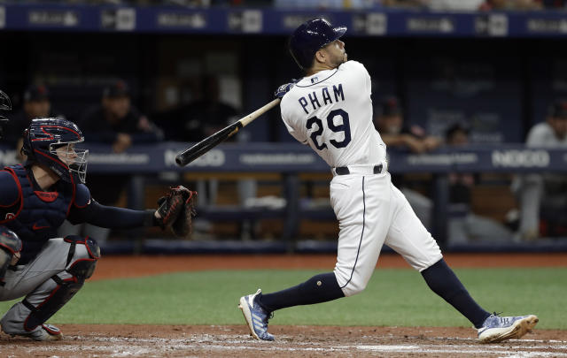 Tampa Bay Rays' Tommy Pham (29) watches his two-run home run off Cleveland Indians starting pitcher Zach Plesac during the third inning of a baseball game Saturday, Aug. 31, 2019, in St. Petersburg, Fla. Catching for Cleveland is Roberto Perez. (AP Photo/Chris O'Meara)