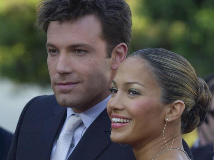 Ben Affleck and Jennifer Lopez are pictured smiling at an event in 2003