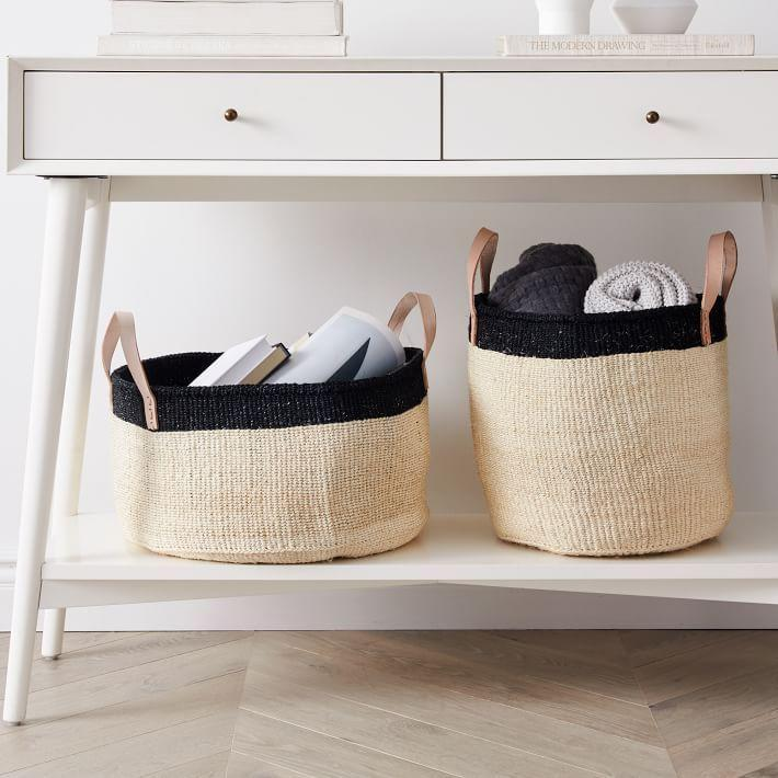 """<p><strong>West Elm</strong></p><p>westelm.com</p><p><a href=""""https://go.redirectingat.com?id=74968X1596630&url=https%3A%2F%2Fwww.westelm.com%2Fproducts%2Fleather-handle-baskets-d8549&sref=https%3A%2F%2Fwww.bestproducts.com%2Fhome%2Fg33012977%2Fwest-elm-summer-home-decor-sale%2F"""" rel=""""nofollow noopener"""" target=""""_blank"""" data-ylk=""""slk:Shop Now"""" class=""""link rapid-noclick-resp"""">Shop Now</a></p><p><del>$100</del><strong><br>$75</strong></p><p>Consider these leather-clad baskets a must-have for anyone who wants to spend quarantine organizing their home. </p>"""