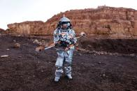 A scientist holds a drone as he participates in a demonstration of an experiment led by Austrian and Israeli agencies simulating a mission to Mars near Mitzpe Ramon, Israel