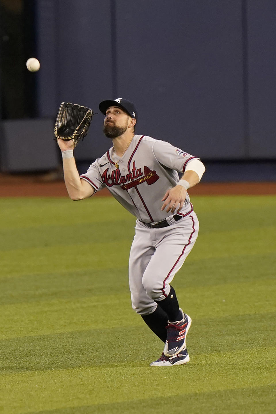 Atlanta Braves center fielder Ender Inciarte catches a sacrifice fly hit by Miami Marlins' Jesus Aguilar that scored Jazz Chisholm Jr. during the first inning of a baseball game, Saturday, June 12, 2021, in Miami. (AP Photo/Wilfredo Lee)