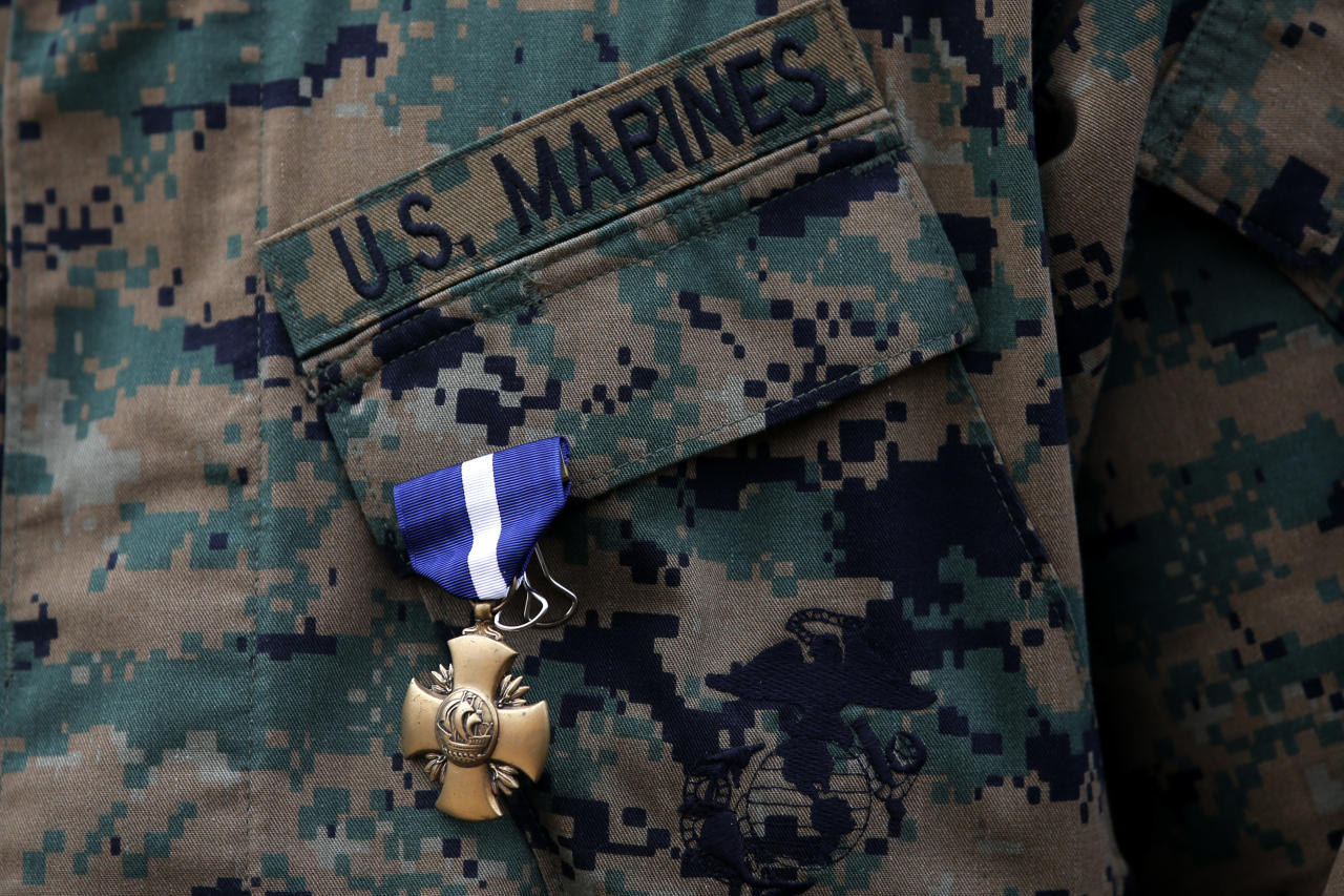 U.S. Marine Sgt. William Soutra Jr. wears the Navy Cross during a ceremony held at Camp Pendleton, Calif., Monday, Dec. 3, 2012. Soutra was awarded the medal for his heroism while serving in Afghanistan. (AP Photo/Jae C. Hong)