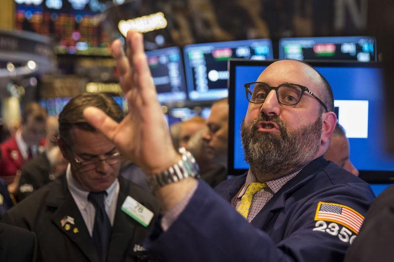 Traders work shortly after the opening bell on the floor of the New York Stock Exchange