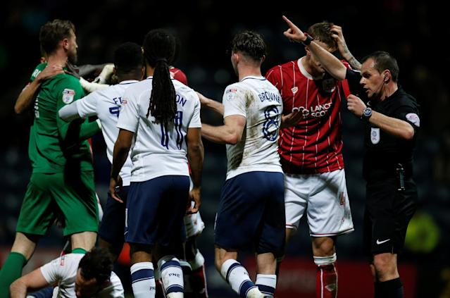 "Soccer Football - Championship - Preston North End vs Bristol City - Deepdale, Preston, Britain - March 6, 2018 Referee Geoff Eltringham sends off Bristol City's Aden Flint Action Images/Ed Sykes EDITORIAL USE ONLY. No use with unauthorized audio, video, data, fixture lists, club/league logos or ""live"" services. Online in-match use limited to 75 images, no video emulation. No use in betting, games or single club/league/player publications. Please contact your account representative for further details."