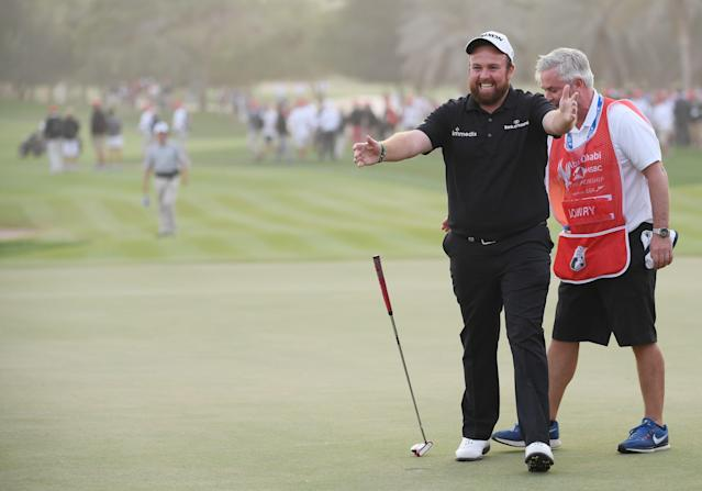 "<h1 class=""title"">Abu Dhabi HSBC Golf Championship - Day Four</h1> <div class=""caption""> ABU DHABI, UNITED ARAB EMIRATES - JANUARY 19: Shane Lowry of Ireland celebrates with caddie Brian ""Bo"" Martin on the 18th green after winning during Day Four of the Abu Dhabi HSBC Golf Championship at Abu Dhabi Golf Club on January 19, 2019 in Abu Dhabi, United Arab Emirates. (Photo by Ross Kinnaird/Getty Images) </div> <cite class=""credit"">Ross Kinnaird</cite>"