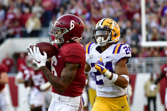 Alabama wide receiver DeVonta Smith (6) makes a catch for a touchdown as LSU cornerback Derek Stingley Jr. (24) defends in the first half of an NCAA college football game, Saturday, Nov. 9, 2019, in Tuscaloosa , Ala. (AP Photo/Vasha Hunt)