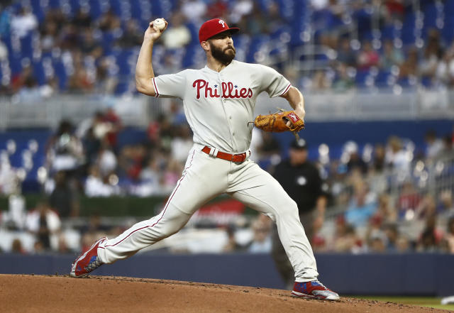 Philadelphia Phillies starting pitcher Jake Arrieta delivers during the first inning of the team's baseball game against the Miami Marlins on Friday, April 12, 2019, in Miami. (AP Photo/Brynn Anderson)