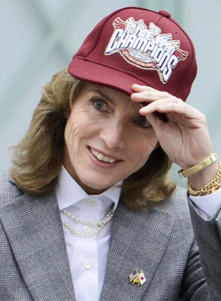 New U.S. Ambassador to Japan Caroline Kennedy puts on a cap of Rakuten Golden Eagles baseball team cap as she poses for a photo during her visit in Sendai, Japan