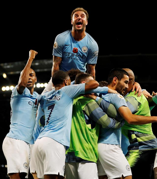 """Soccer Football - Premier League - Manchester City v Manchester United - Etihad Stadium, Manchester, Britain - November 11, 2018 Manchester City's Ilkay Gundogan celebrates scoring their third goal with teammates REUTERS/Darren Staples EDITORIAL USE ONLY. No use with unauthorized audio, video, data, fixture lists, club/league logos or """"live"""" services. Online in-match use limited to 75 images, no video emulation. No use in betting, games or single club/league/player publications. Please contact your account representative for further details. TPX IMAGES OF THE DAY"""