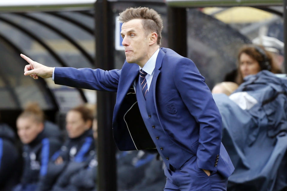 "FILE - England coach Phil Neville instructs his team against France during the first half of a SheBelieves Cup women's soccer match in Columbus, Ohio, in this Thursday, March 1, 2018, file photo. David Beckham bristled when asked whether Phil Neville's was hired as Inter Miami coach because they're buddies. ""Of course, people are always going to turn around and say, oh, it's because he's your friend. It's nothing to do with him being my friend,"" Beckham said Friday, Jan. 22, 2021. (AP Photo/Jay LaPrete, FIle)"