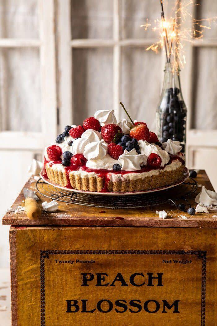 "<a href=""https://www.halfbakedharvest.com/no-bake-eton-mess-berry-cheesecake/"" rel=""nofollow noopener"" target=""_blank"" data-ylk=""slk:Get the No-Bake Eton Mess Berry Cheesecake recipe from Half Baked Harvest"" class=""link rapid-noclick-resp""><strong>Get the No-Bake Eton Mess Berry Cheesecake recipe from Half Baked Harvest</strong></a>"