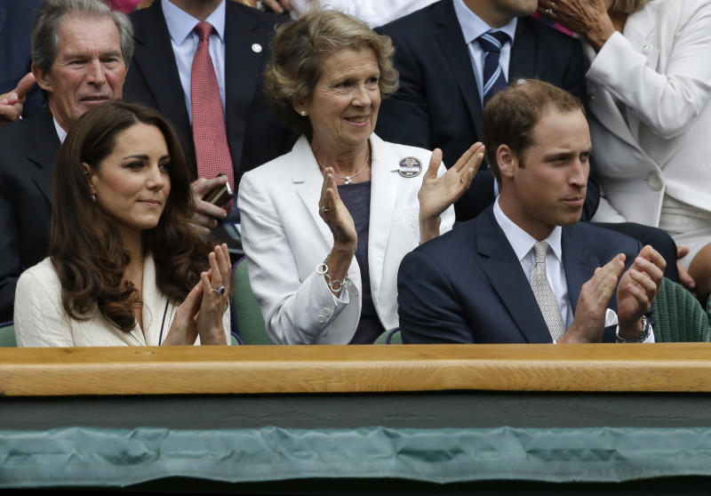 Britain's Prince William, right, and his wife Kate, Duchess of Cambridge applaud ahead of a quarterfinals match between Roger Federer of Switzerland and Mikhail Youzhny of Russia at the All England Lawn Tennis Championships at Wimbledon, England, Wednesday July 4, 2012. (AP Photo/Anja Niedringhaus)