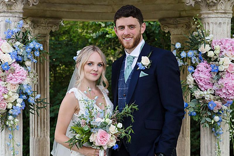 The Thames Valley police officer with his wife Lissie at the couple's wedding just four before his death (Mark Lord via AP)