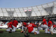 Members of the Boston Red Sox warm up before batting practice in London, Friday, June 28, 2019. Major League Baseball will make its European debut with the New York Yankees versus Boston Red Sox game at London Stadium this weekend. (AP Photo/Frank Augstein)