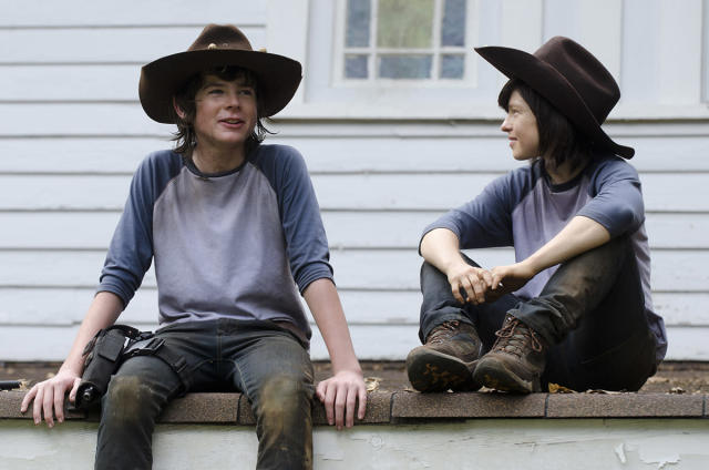 <p>Nope, it's Chandler Riggs and his Carl Grimes stunt double, 32-year-old stuntwoman Emily Brobst.<br><br>(Photo: AMC) </p>