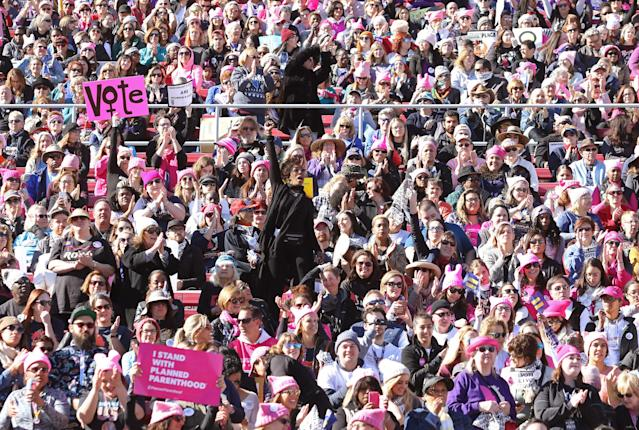<p>The crowd at Sam Boyd Stadium had the feel of a mellow, happy concert — with lots of pussy hats. (Photo: Ronda Churchill for Yahoo Lifestyle) </p>
