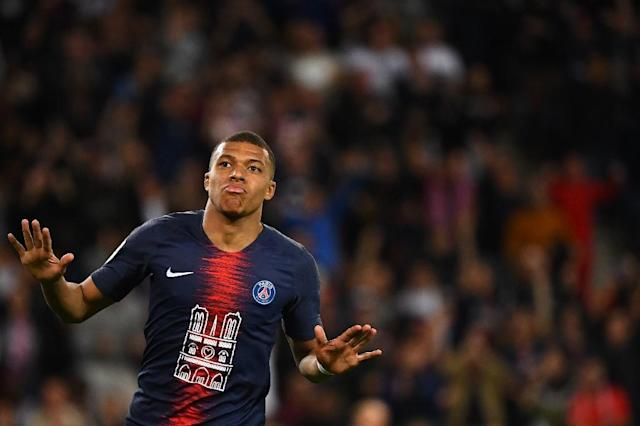 France's World Cup winner Kylian Mbappe scored a hat-trick against Monaco in a shirt paying tribute to the Notre Dame (AFP Photo/FRANCK FIFE)