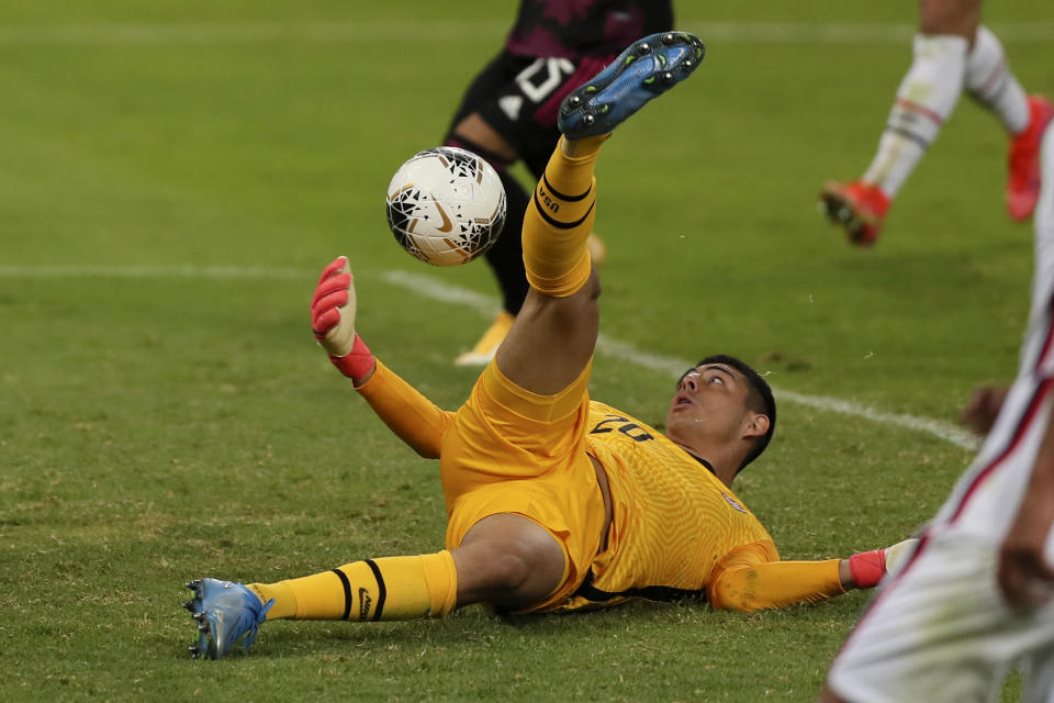 United States goalkeeper David Ochoa catches the ball during a Concacaf Men's Olympic Qualifying championship soccer match against Mexico, in Guadalajara, Mexico, Wednesday, March 24, 2021. (AP Photo/Fernando Llano)