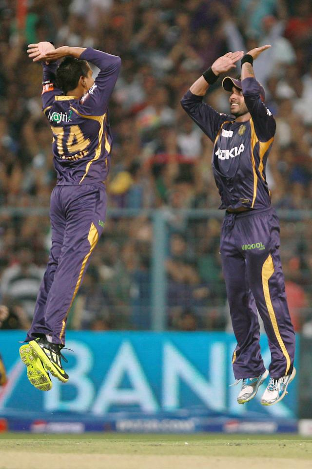 Sunil Narine and Manoj Tiwary celebrate the wicket of Dwayne Smith during match 33 of the Pepsi Indian Premier League between The Kolkata Knight Riders and The Mumbai Indians held at Eden Gardens Stadium, Kolkata on the 24th April 2013.  (BCCI)