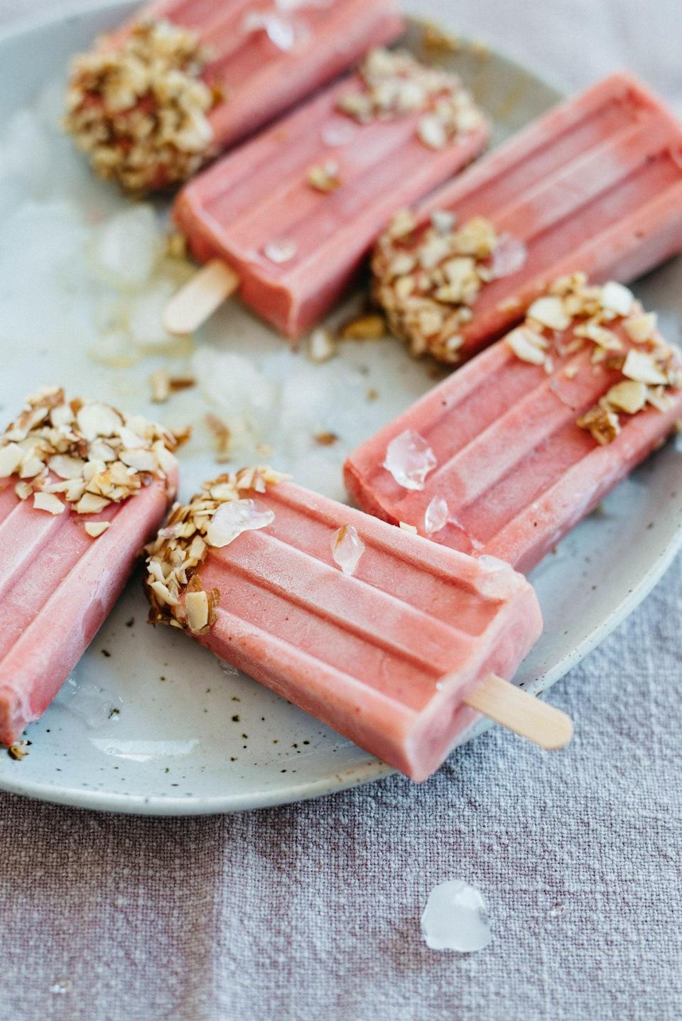 """<p>Tomatoes may not <em>seem</em> like the foundation of a good dessert, but these yogurt pops deliver. They're sweetened with just a touch of coconut nectar and topped with crunchy sliced almonds.</p> <p><strong>Get the recipe:</strong> <a href=""""http://www.dollyandoatmeal.com/blog/2017/6/28/raspberry-tomato-yogurt-pops"""" class=""""link rapid-noclick-resp"""" rel=""""nofollow noopener"""" target=""""_blank"""" data-ylk=""""slk:raspberry-tomato yogurt popsicles"""">raspberry-tomato yogurt popsicles</a></p>"""