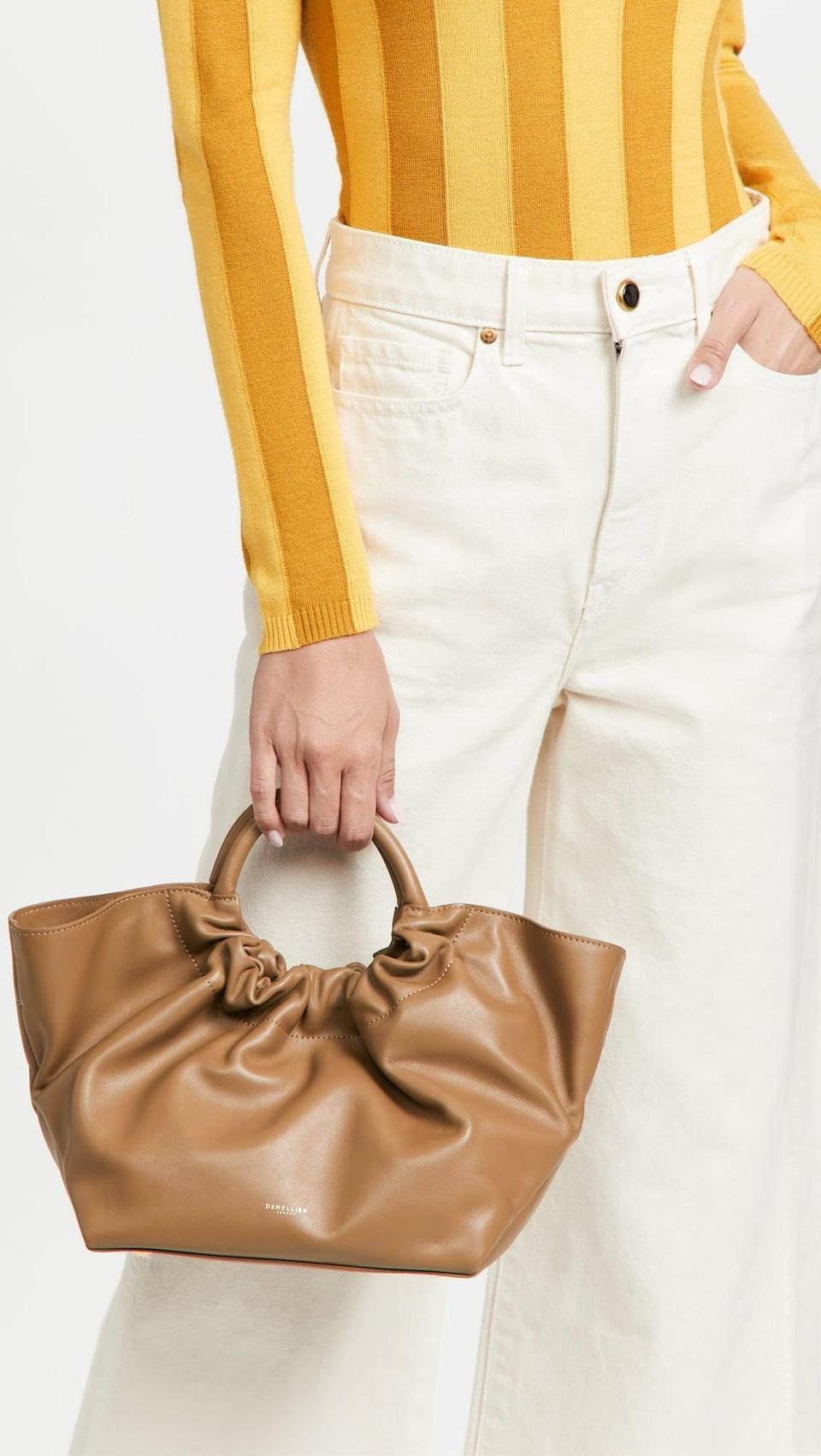 <p>Carry all your necessities in this cute and handy <span>DeMellier Midi Los Angeles Tote</span> ($455). It also comes with a crossbody strap, for easy carrying.</p>