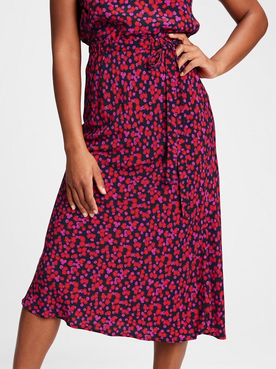 <p>This pink floral <span>Gap Side-Tie Midi Skirt</span> ($40, originally $70) would look great with a turtleneck and knee-high boots!</p>