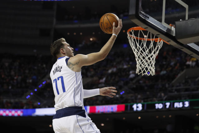 Dallas Mavericks' Luka Doncic goes for the basket in the first half of their regular-season NBA basketball game against Detroit Pistons in Mexico City, Thursday, Dec. 12, 2019. (AP Photo/Rebecca Blackwell)